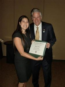 Dr. Stephanie Woo receiving her FAAO with Dr. Ed. Bennett