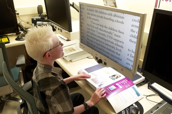 A low vision patient using adaptive technology: a digital camera provides an image on a large screen giving the patient ample magnification