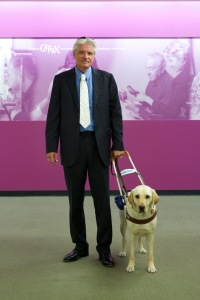 Wayne Heidle with his guide dog, Pancho, are regulars at the University Eye Center