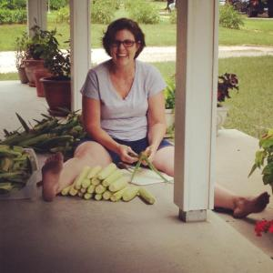 """This is one of my favorite pictures of my mom. A typical day at home involves picking corn from our garden, and me reading on the front porch on our swing."""