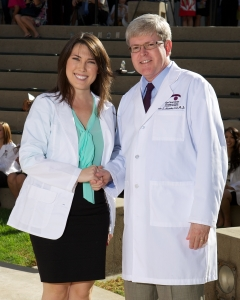 Maggie at the Class of 2016 White Coat Ceremony being congratulated by MBKU President, Dr. Kevin Alexander
