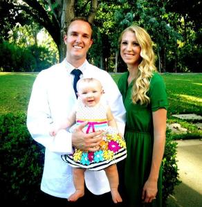 Class of 2017's Adam Rosa at MBKU's White Coat Ceremony with his wife Brittany and daughter Joselyn