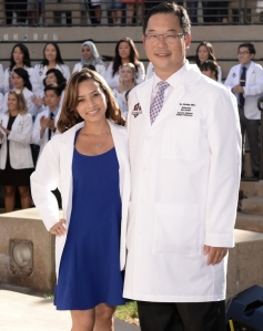 First Year Student Cynthia Palma at her White Coat Ceremony with Dean Woo