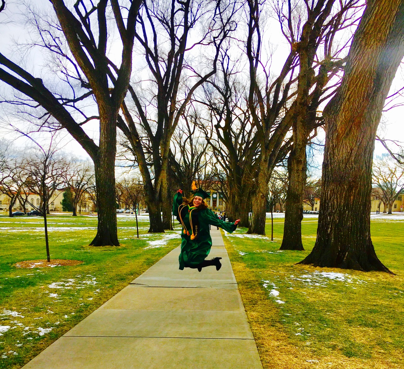 A picture of me jumping for joy because I graduated college!!