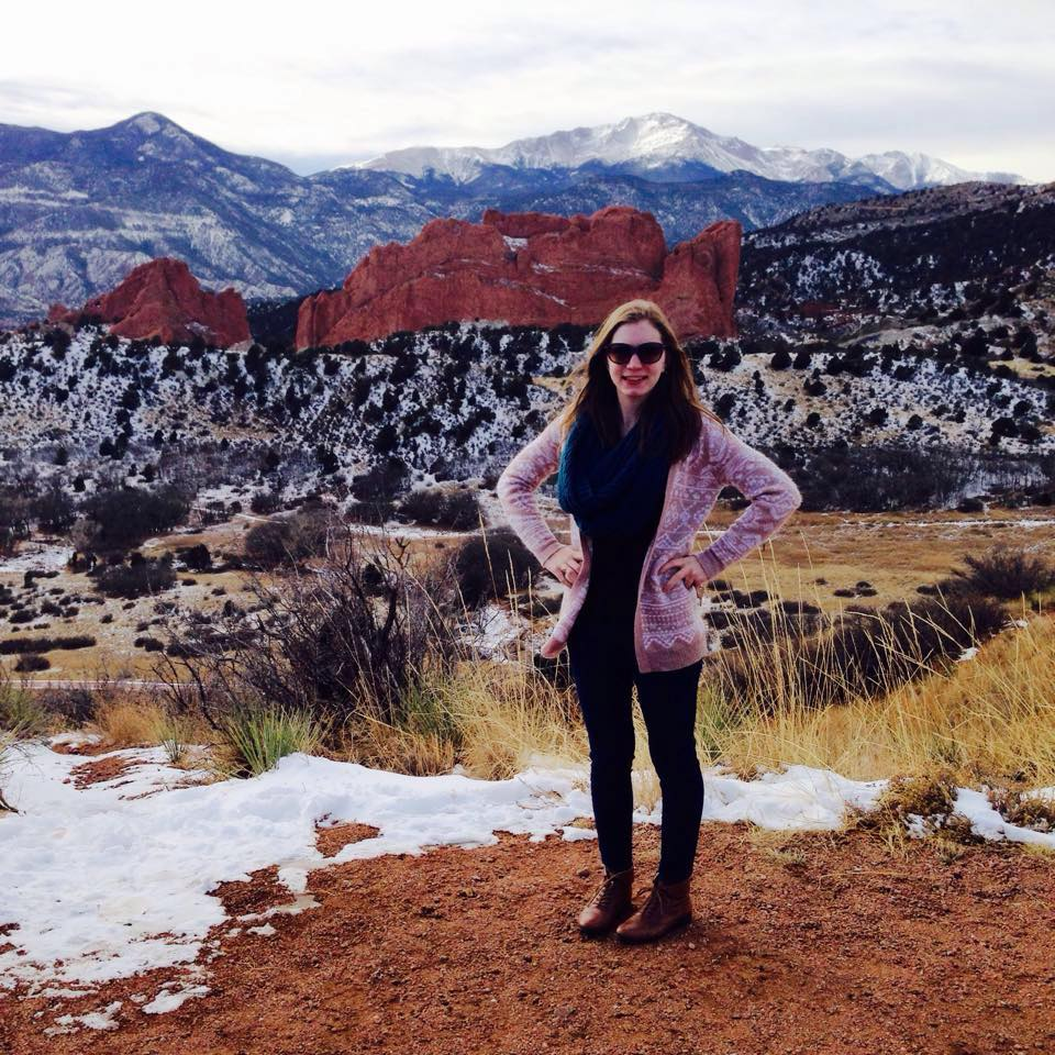 Me in my hometown Colorado Springs with Garden of the Gods and Pike's Peak behind me