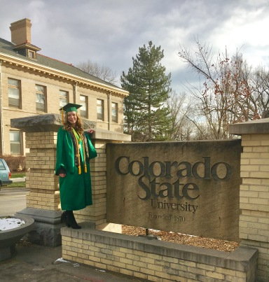 Undergrad graduation pic with Colorado State sign